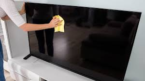 shows cleaning a TV screen with dry cloth